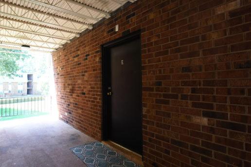 Brick building and cement floor, Door E