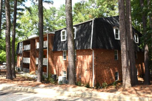 exterior of brick building, balconies, trees
