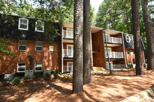 exterior of brick building 210, balconies, trees