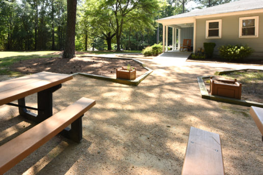 Picnic tables, gravel, exterior buiilding, grass area